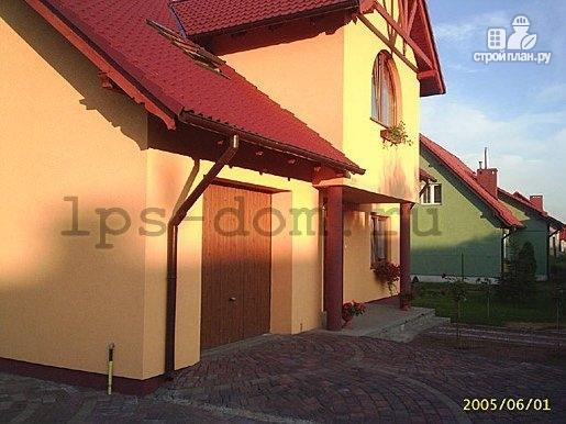 Фото 14: проект каркасный дом с террасой, балконом и гаражом