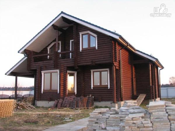 Фото 2: проект бревенчатый дом 11х13 с навесом для машины