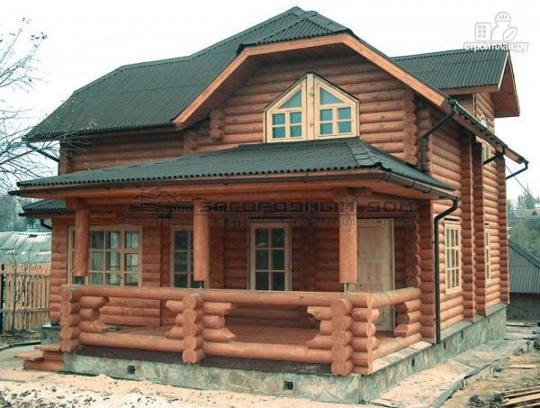 Фото: проект бревенчатый дом с полувальмовой крышей для дружной семьи