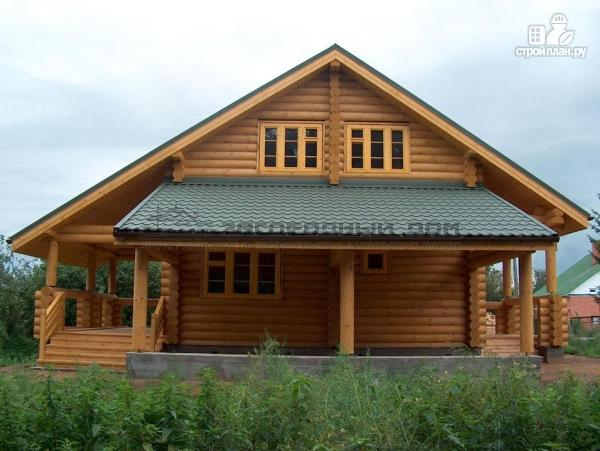 Фото 4: проект деревянный дом с балконом, террасой, вторым светом и навесом для машины