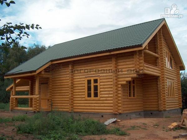 Фото 6: проект деревянный дом с балконом, террасой, вторым светом и навесом для машины