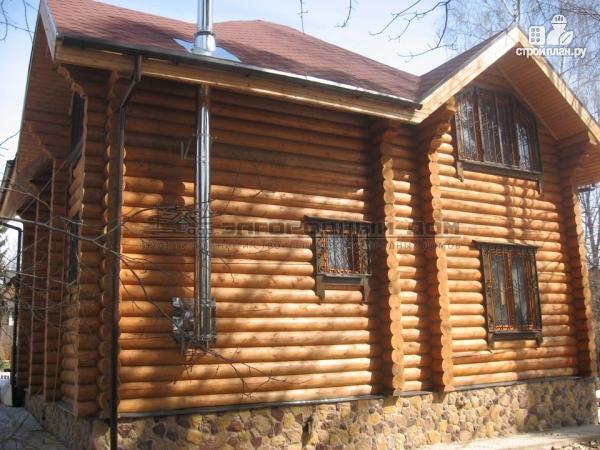 Фото 6: проект дом из оцилиндрованного бревна с большой террасой