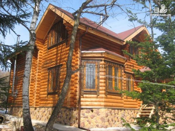 Фото 5: проект дом из оцилиндрованного бревна с большой террасой