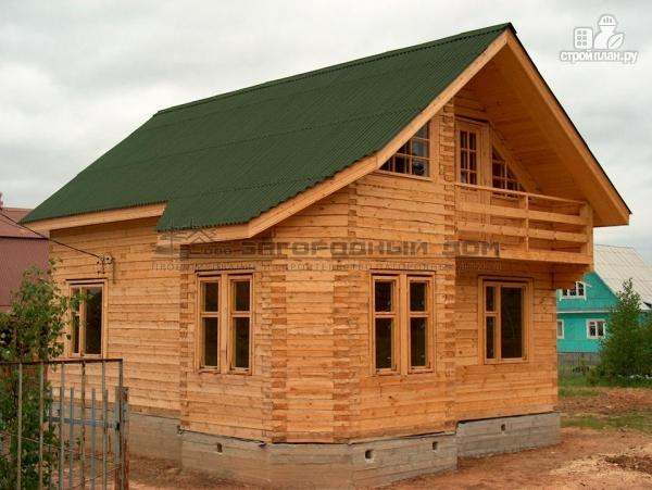 Фото 6: проект брусовой дом с эркером и террасой с навесом