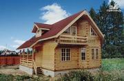 Фото: брусовой дом с эркером и террасой с навесом