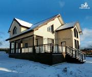 Фото: дом из бруса с широкой террасой
