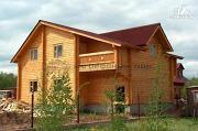 Фото: дом из бруса с балконом и гаражом