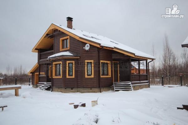 Фото 4: проект дом из бруса с балконом, террасой и гаражом