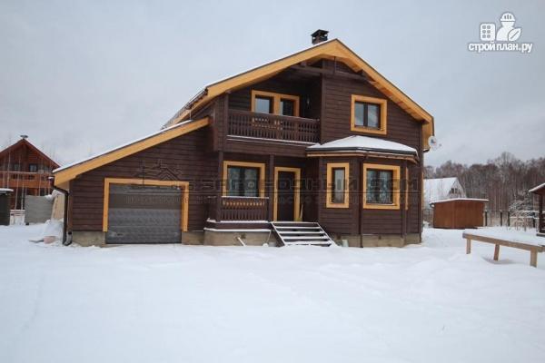 Фото: проект дом из бруса с балконом, террасой и гаражом