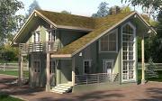 Фото: дом с террасой, балконом и вторым светом в эркере гостиной