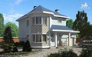 Фото: двухэтажный дом из газобетона с террасой и эркерами