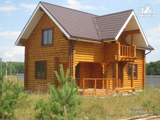 Фото: проект дом из бревна с мансардой, террасой и балконом