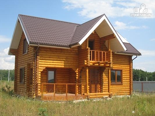 Фото 2: проект дом из бревна с мансардой, террасой и балконом