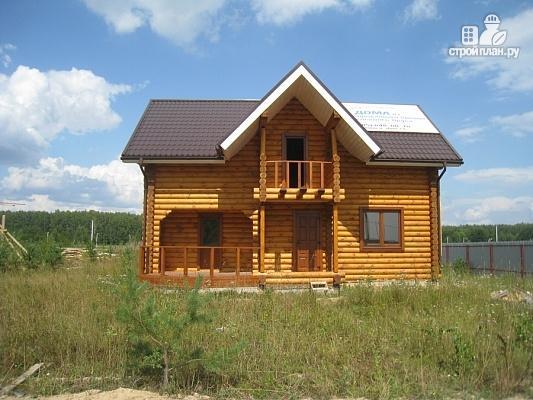 Фото 3: проект дом из бревна с мансардой, террасой и балконом