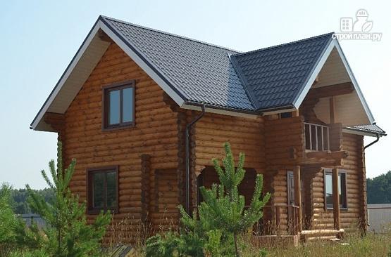 Фото 4: проект дом из бревна с мансардой, террасой и балконом