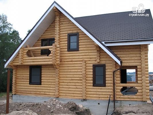 Фото 4: проект бревенчатый дом с террасой и двумя балконами