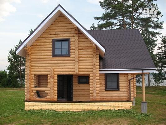 Фото 2: проект бревенчатый дом с террасой и двумя балконами