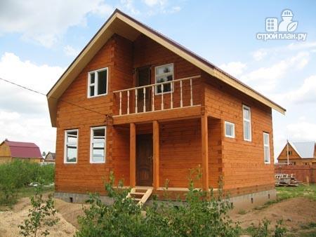Фото 11: проект дом из бруса 7,5х7,5 с балконом и крыльцом