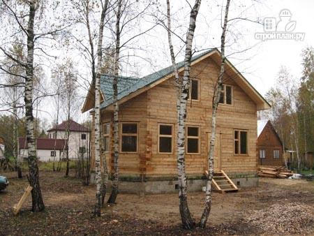 Фото 10: проект дом из бруса 7,5х7,5 с балконом и крыльцом