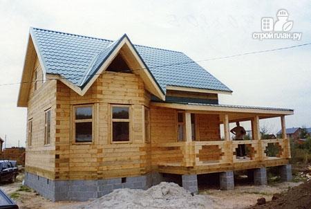 Фото 9: проект дом из бревна 7х8 с угловой террасой