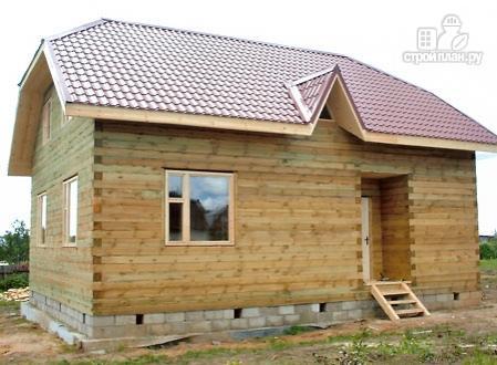 Фото 9: проект дом из бруса с вальмовой крышей и эркером