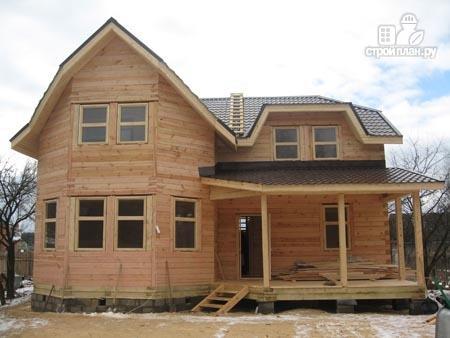 Фото 8: проект дом из бруса 11х11 с угловой террасой и балконом