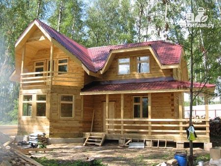 Фото 11: проект дом из бруса 11х11 с угловой террасой и балконом