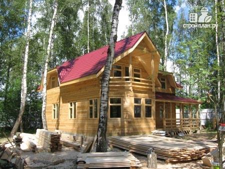 Фото 9: проект дом из бруса 11х11 с угловой террасой и балконом