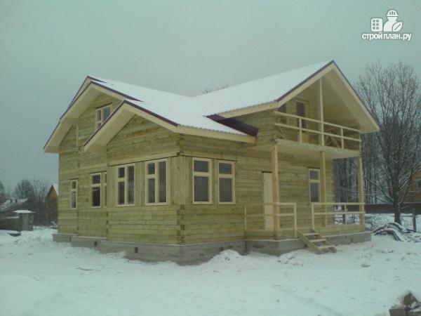 Фото 8: проект деревянный дом 12х12 с балконом, террасой и двухсветной гостиной