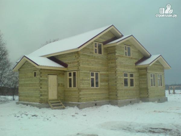 Фото 9: проект деревянный дом 12х12 с балконом, террасой и двухсветной гостиной