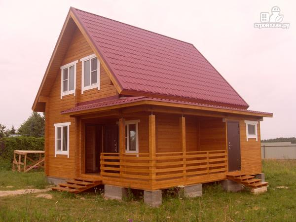 Фото 5: проект уютный дачный дом из клееного бруса с просторной зоной кухни-гостинной
