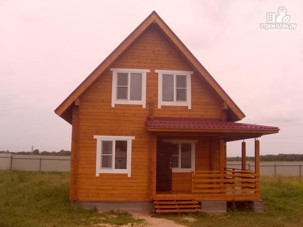Фото 4: проект уютный дачный дом из клееного бруса с просторной зоной кухни-гостинной