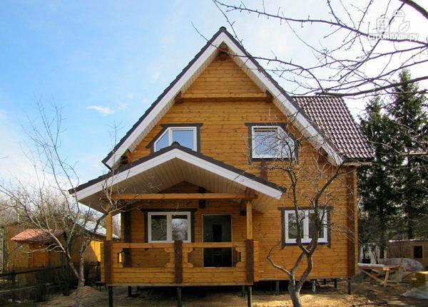 Фото 4: проект изящный загородный коттедж в современном стиле, построенный из клееного бруса