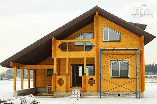 Фото: проект дом из бруса с навесом для гаража