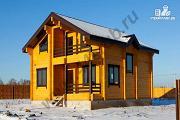 Фото: двухэтажный дом из бруса с двумя входами