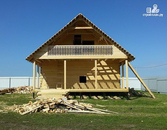 Фото 2: проект дом из бруса с террасой и балконом